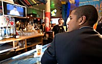 Watching-TV-in-Bar-A