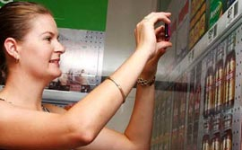 Woman-Scanning-QR-Code-In-Store-B